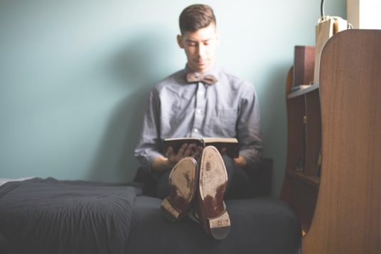young man reading image
